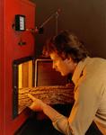 Discontinued wood boilers man filling boiler