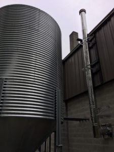 Exterior View of 2 Chimneys and Silo